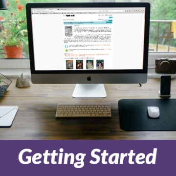 "desktop computer with ""getting started"" banner"